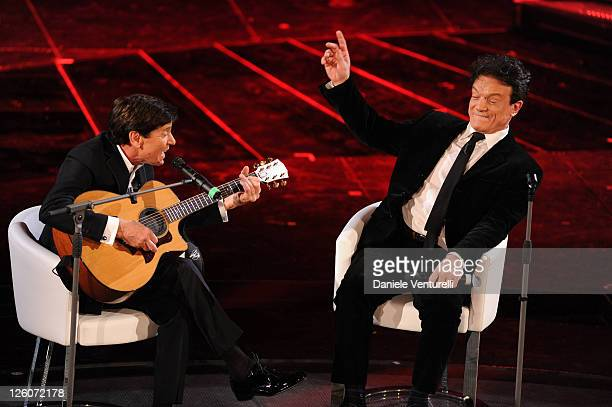 Gianni Morandi and Massimo Ranieri attend the closing night of the 61st Italian Song Festival at the Ariston Theatre on February 19, 2011 in San...