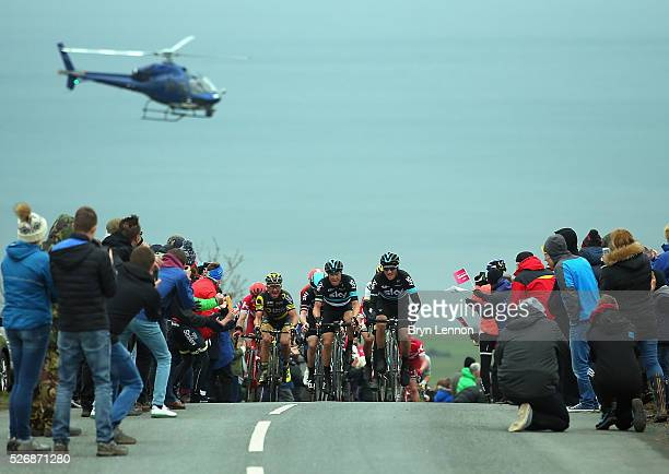 Gianni Moscon and Nicolas Roche of Team SKY and Thomas Voeckler of France and Direct Energie climb out of Robin Hood's Bay on stage three of the 2016...