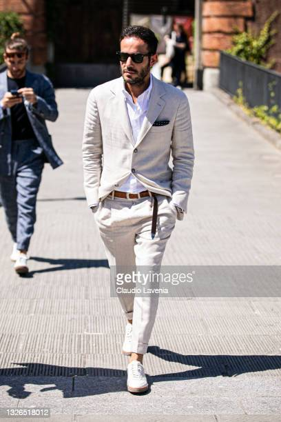 Gianni Sistoni wearing a beige Brunello Cucinelli suits, is seen at Fortezza Da Basso on July 01, 2021 in Florence, Italy.