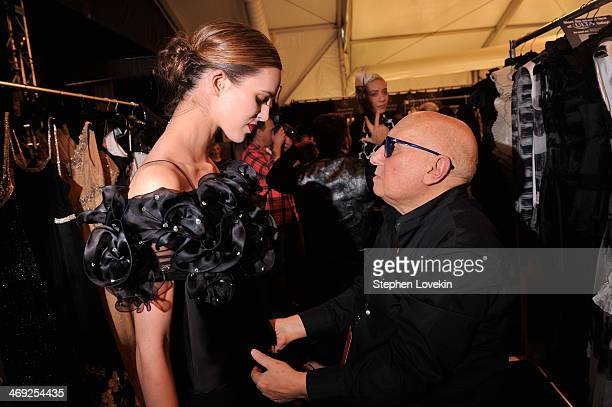 Gianni Tolentino prepares backstage at the FLT Moda Art Hearts Fashion show presented by AIDS Healthcare Foundation during MercedesBenz Fashion Week...