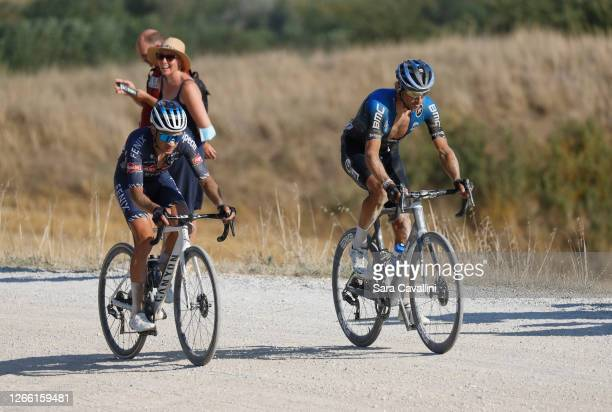 Gianni Vermeersch of team Alpecin-Fenix and Roman Kreuziger of NTT Pro cycling team, riding on sector 8 of Strade Bianche race, on August 01, 2020 in...