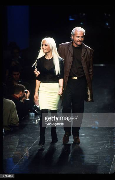Gianni Versace and his sister Donatella Versace walk on stage after their Spring 97 Fashion Show at 7th on Sixth October 26, 1996 in New York City....