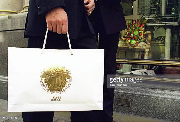 Gianni Versace Carrier Bag Carried Outside Versace Shop In Bond Street
