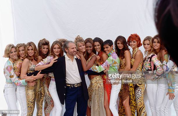 Gianni Versace poses with a group of models wearing his springsummer collection in Milan March 1991