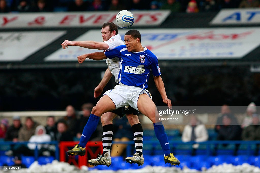 Gianni Zuiverloon (R) of Ipswich battles for the ball against Craig Beattie of Swansea during the npower Championship match between Ipswich Town and Swansea City at Portman Road on December 4, 2010 in Ipswich, England.