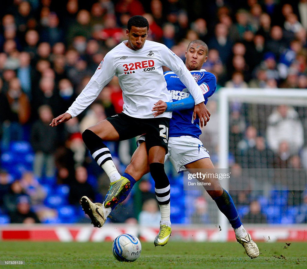 Gianni Zuiverloon (R) of Ipswich battles for the ball against Scott Sinclair of Swansea during the npower Championship match between Ipswich Town and Swansea City at Portman Road on December 4, 2010 in Ipswich, England.