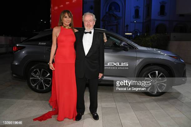 """Giannina Facio and Director Ridley Scott arrive on the red carpet ahead of the """"The Last Duel"""" screening during the 78th Venice Film Festival on..."""