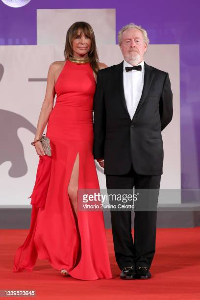 """Giannina Facio and Director Ridley Scott attend the red carpet of the movie """"The Last Duel"""" during the 78th Venice International Film Festival on..."""