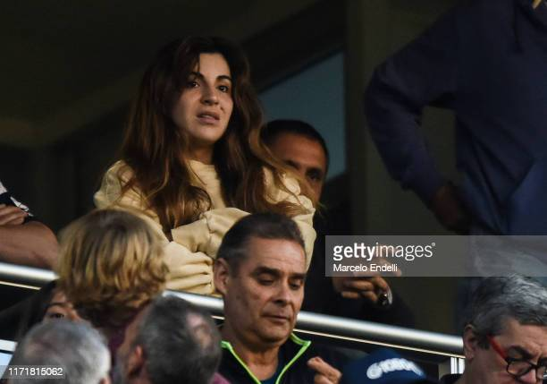 Giannina Maradona daughter of Diego Maradona watches the match from the stands between Gimnasia y Esgrima La Plata and River Plate as part of...