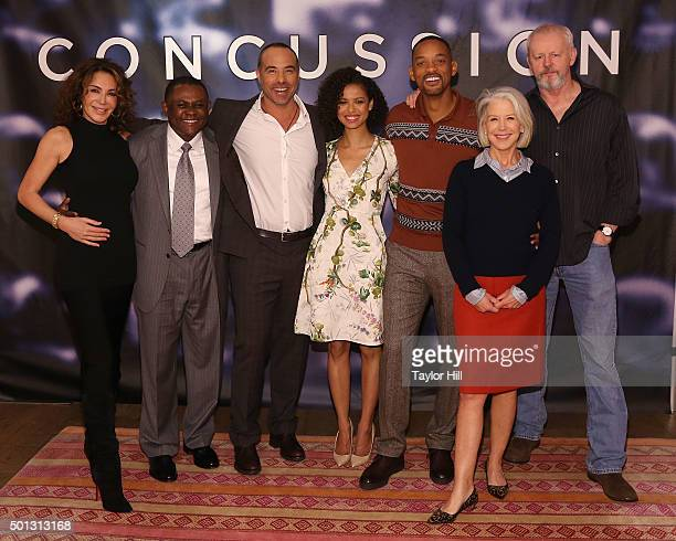 Giannina Scott, Dr. Bennet Omalu, Peter Landesman, Gugu Mbatha-Raw, Will Smith, Elizabeth Cantillon, and David Morse attend a photocall for...