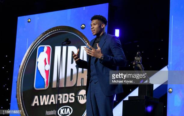 Giannis Antetokounmpo accepts the Kia NBA Most Valuable Player award onstage during the 2019 NBA Awards presented by Kia on TNT at Barker Hangar on...