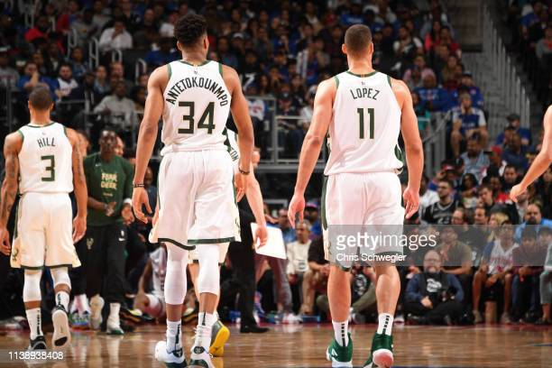 Giannis Antetokounmpo and Brook Lopez of the Milwaukee Bucks look on against the Detroit Pistons during Game Four of Round One of the 2019 NBA...