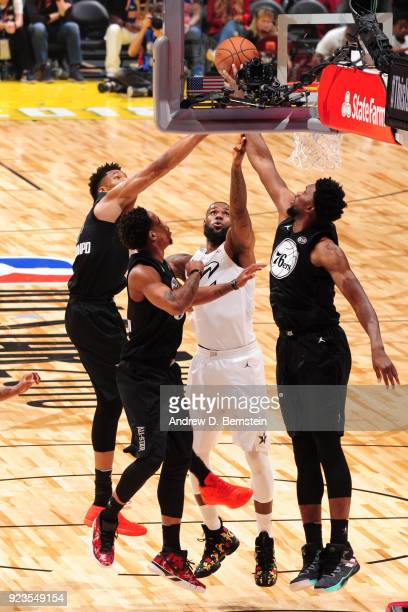 Giannis Antetokounmpo and Joel Embiid of team Stephen block the shot by LeBron James of team LeBron during the NBA AllStar Game as a part of 2018 NBA...