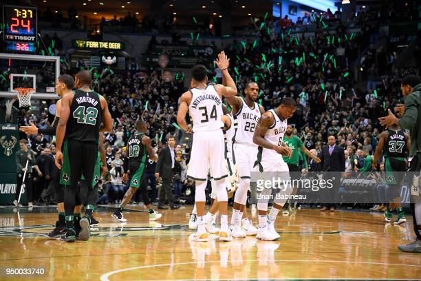 Giannis Antetokounmpo and Khris Middleton of the Milwaukee Bucks react during game against the Boston Celtics in Game Four of Round One of the 2018...