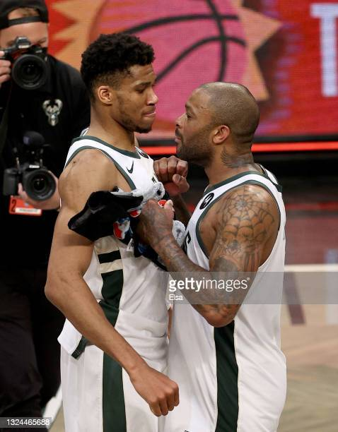 Giannis Antetokounmpo and P.J. Tucker of the Milwaukee Bucks celebrate the win after game seven of the Eastern Conference second round at Barclays...