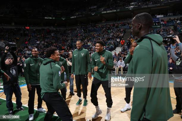 Giannis Antetokounmpo and Rashad Vaughn of the Milwaukee Bucks with their teammates huddle before the game against the Indiana Pacers on January 3...