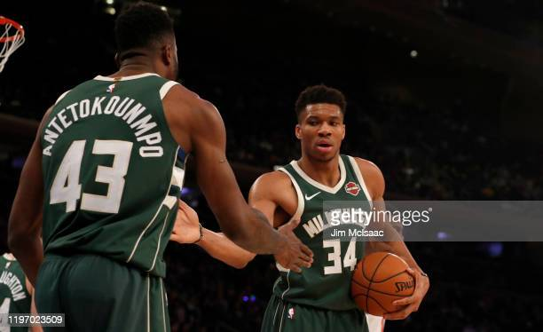 Giannis Antetokounmpo and Thanasis Antetokounmpo of the Milwaukee Bucks in action against the New York Knicks at Madison Square Garden on December 21...