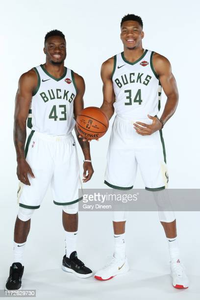 Giannis Antetokounmpo and Thanasis Antetokounmpo of the Milwaukee Bucks pose for a portrait during Media Day at Fiserv Forum on September 30 2019 in...