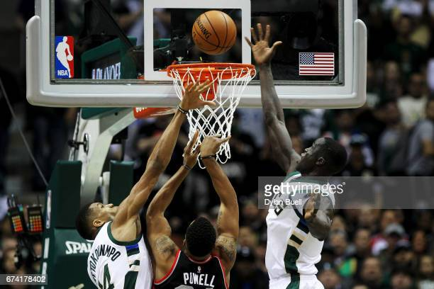 Giannis Antetokounmpo and Thon Maker of the Milwaukee Bucks block a shot attempt by Norman Powell of the Toronto Raptors in the first quarter in Game...