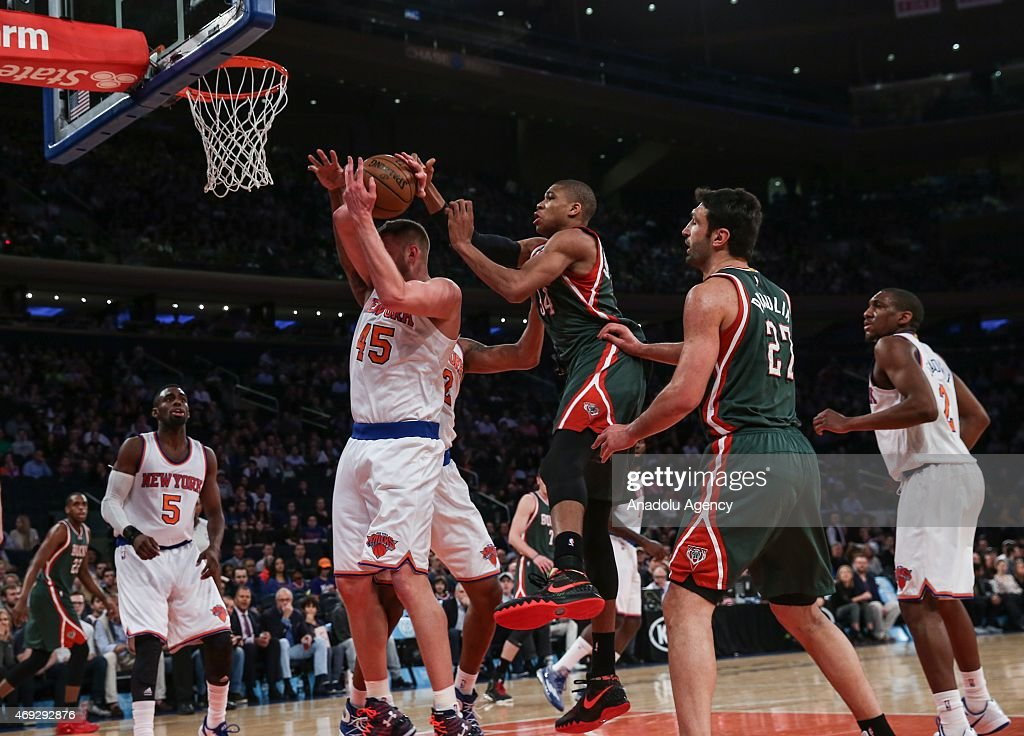 Giannis Antetokounmpo #34 and Zaza Pachulia #27 of the Milwaukee Bucks in action against Cole Aldrich #45 and Tim Hardaway Jr. #5 of the New York Knicks at Madison Square Garden on April 10, 2015 in New York, New York.