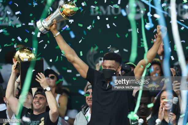 Giannis Antetokounmpo celebrates with the Larry O'Brien trophy during the Milwaukee Bucks 2021 NBA Championship Victory Parade and Rally in the Deer...