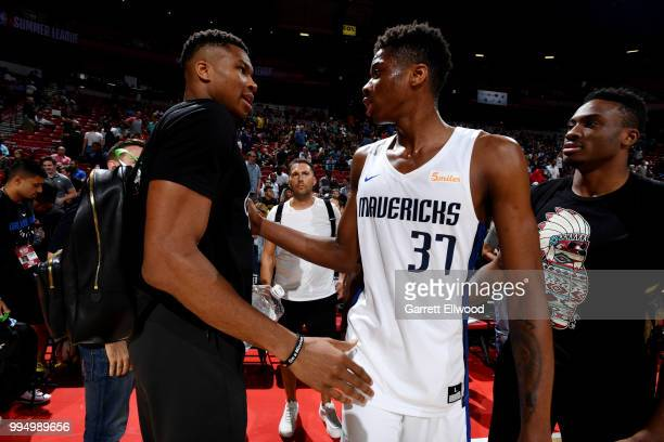 Giannis Antetokounmpo exchanges handshakes with his brother Kostas Antetokounmpo of the Dallas Mavericks after the game against the Golden State...