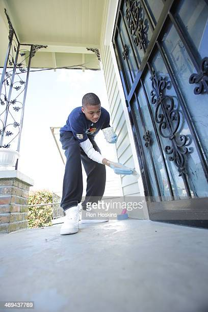 Giannis Antetokounmpo helps paint at the NBA Cares AllStar Day of Service LIVE with Rebuilding Together as part of the 2014 NBA AllStar Weekend on...