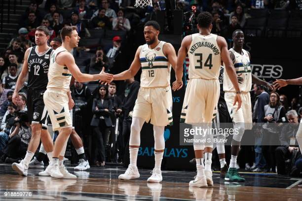 Giannis Antetokounmpo Matthew Dellavedova and Jabari Parker of the Milwaukee Bucks high five against the Brooklyn Nets on February 4 2018 at Barclays...