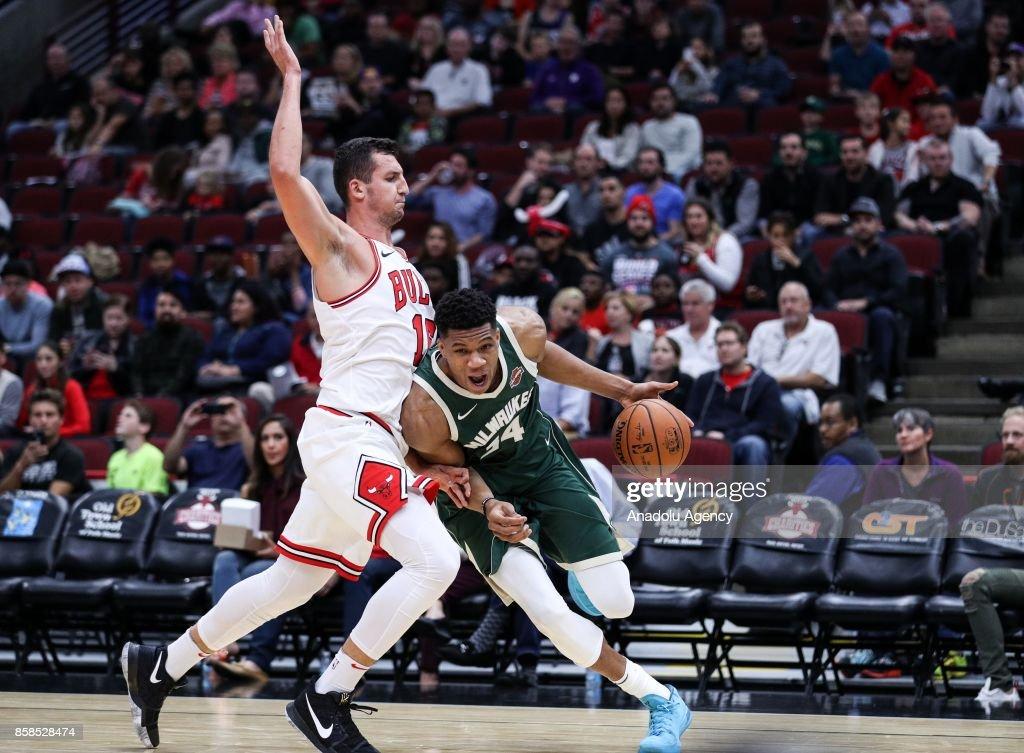 Giannis Antetokounmpo (34) of Milwaukee Bucks in action against Paul Zipser (16) of Chicago Bulls during the preseason NBA game between Chicago Bulls and Milwaukee Bucks, in Chicago, United States, on October 6, 2017.