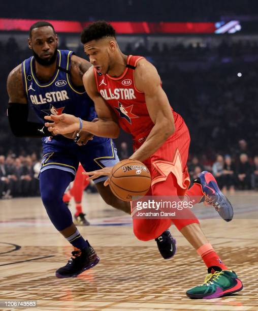 Giannis Antetokounmpo of Team Giannis dribbles the ball while being guarded by LeBron James of Team LeBron in the first quarter during the 69th NBA...