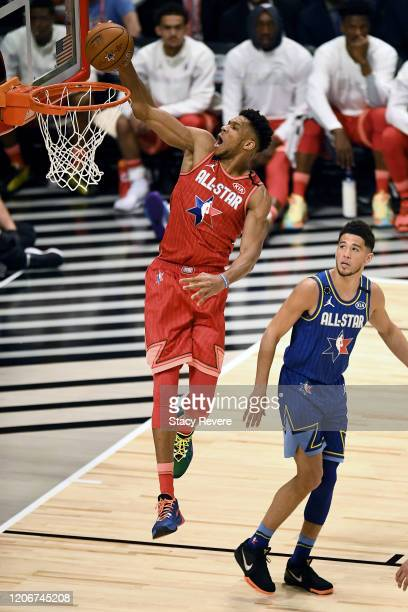 Giannis Antetokounmpo of Team Giannis dunks the ball past Devin Booker of Team LeBron in the first quarter during the 69th NBA All-Star Game at the...