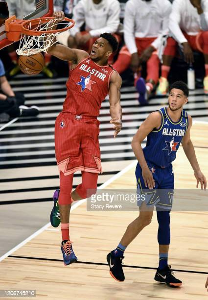 Giannis Antetokounmpo of Team Giannis dunks the ball past Devin Booker of Team LeBron in the first quarter during the 69th NBA AllStar Game at the...