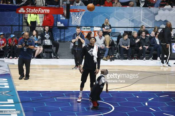 Giannis Antetokounmpo of Team Giannis watches a fan shoot the ball during the 2019 NBA AllStar Practice Media Day presented by ATT on February 16...