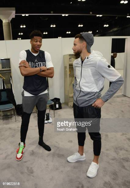 Giannis Antetokounmpo of team Stephen and Stephen Curry of team Stephen talk before the 2018 NBA All Star Practice as part of 2018 AllStar Weekend at...