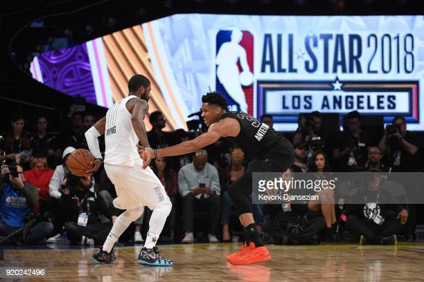 Giannis Antetokounmpo of Team Stephen defends Kyrie Irving of Team LeBron during the NBA AllStar Game 2018 at Staples Center on February 18 2018 in...