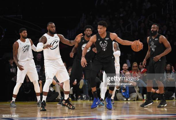 Giannis Antetokounmpo of Team Stephen dribbles the ball against LeBron James of Team LeBron during the NBA AllStar Game 2018 at Staples Center on...