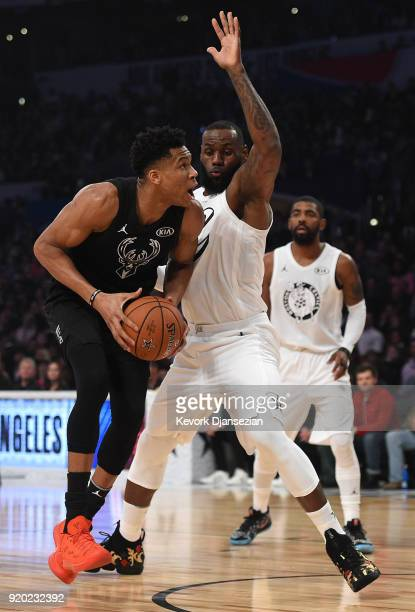 Giannis Antetokounmpo of Team Stephen drives on LeBron James of Team LeBron during the NBA AllStar Game 2018 at Staples Center on February 18 2018 in...