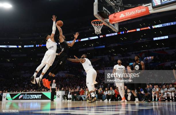 Giannis Antetokounmpo of Team Stephen drunks over Russell Westbrook and LeBron James of Team LeBron during the NBA AllStar Game 2018 at Staples...