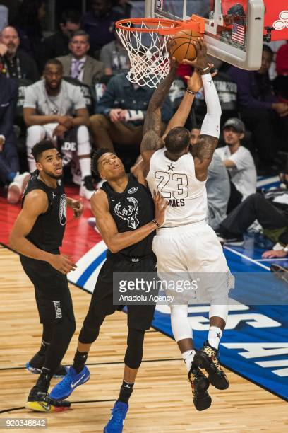 Giannis Antetokounmpo of Team Stephen fouls LeBron James of Team Lebron in the fourth quarter during the 2018 NBA AllStar Game at the Staples Center...