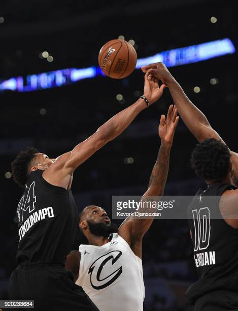 Giannis Antetokounmpo of Team Stephen scraps for the ball with LeBron James of Team LeBron during the NBA AllStar Game 2018 at Staples Center on...