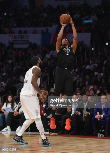 Giannis Antetokounmpo of Team Stephen shoots a jump shot over Kyrie Irving of Team LeBron during the NBA AllStar Game 2018 at Staples Center on...