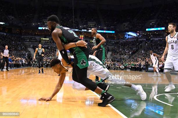 Giannis Antetokounmpo of the Milwaukee Bucks and Jaylen Brown of the Boston Celtics go for a loose ball in Game Four of Round One of the 2018 NBA...