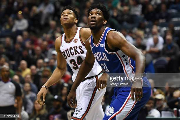Giannis Antetokounmpo of the Milwaukee Bucks and Joel Embiid of the Philadelphia 76ers wait for a rebound during the first half of a game at the...