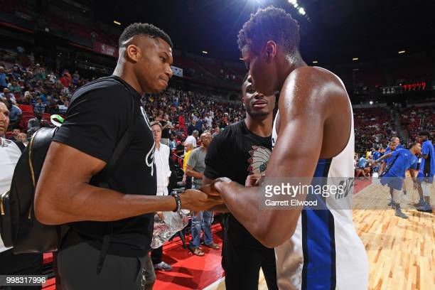 Giannis Antetokounmpo of the Milwaukee Bucks and Kostas Antetokounmpo of the Dallas Mavericks talk after the game against the Golden States Warriors...
