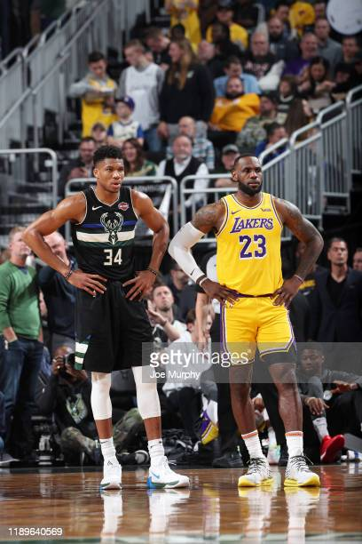 Giannis Antetokounmpo of the Milwaukee Bucks and LeBron James of the Los Angeles Lakers look on during a game on December 19 2019 at the Fiserv Forum...