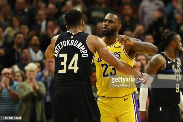 Giannis Antetokounmpo of the Milwaukee Bucks and LeBron James of the Los Angeles Lakers hug following a game at Fiserv Forum on December 19 2019 in...