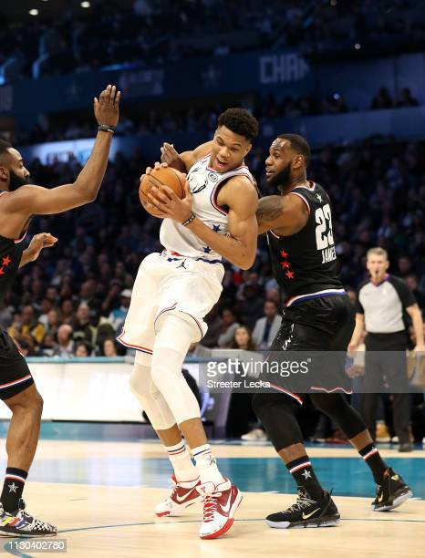 Giannis Antetokounmpo of the Milwaukee Bucks and Team Giannis fights to keep the ball against LeBron James of the LA Lakers and Team LeBron in the...