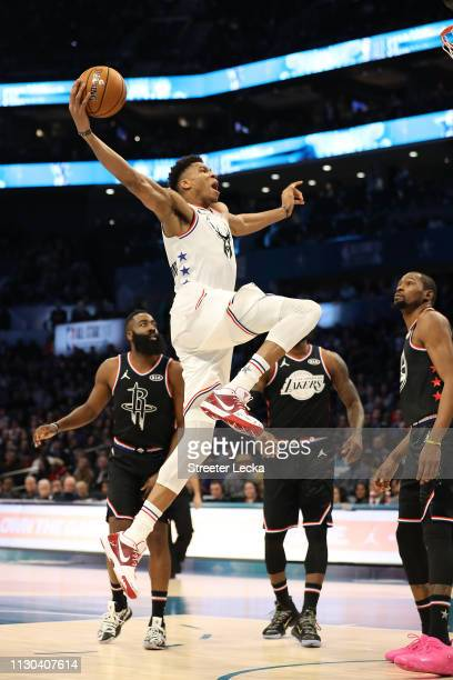 Giannis Antetokounmpo of the Milwaukee Bucks and Team Giannis goes up to dunk against James Harden of the Houston Rockets and Kevin Durant of the...