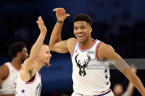Giannis Antetokounmpo of the Milwaukee Bucks and Team Giannis celebrates with Stephen Curry of the Golden State Warriors against Team LeBron in the...