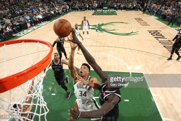 Giannis Antetokounmpo of the Milwaukee Bucks and Thon Maker of the Detroit Pistons go up for the rebound during Game Two of Round One of the 2019 NBA...